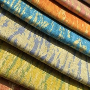 gold thread fat quarters in orange, beige, blue and yellow
