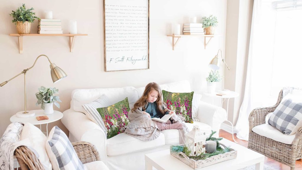 white living room with snap dragon pillows.