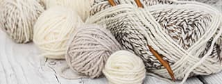 Odds and Bobbs white yarn and knitting