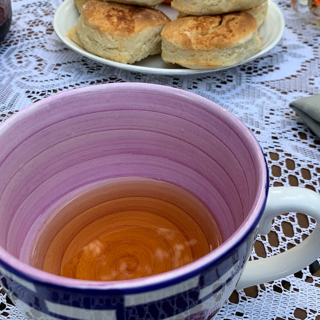 Tea in a tea cup that is a medium amber color.